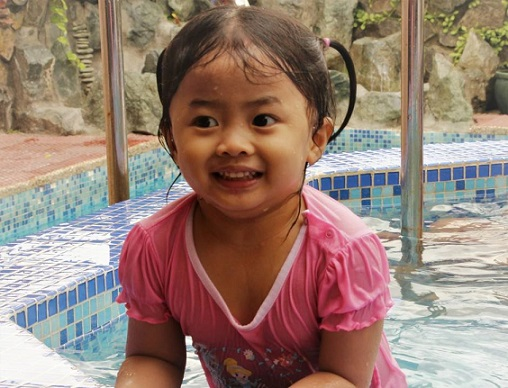Maggie, a beautiful Filipino child. Happy a smiling, like all Filipino kids.