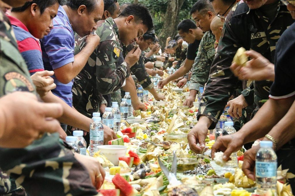 A boodle fight where hygiene goes out the window